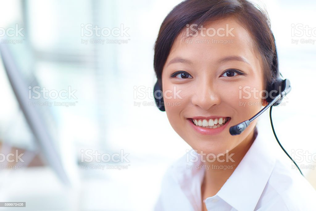young woman working in the call centre stock photo