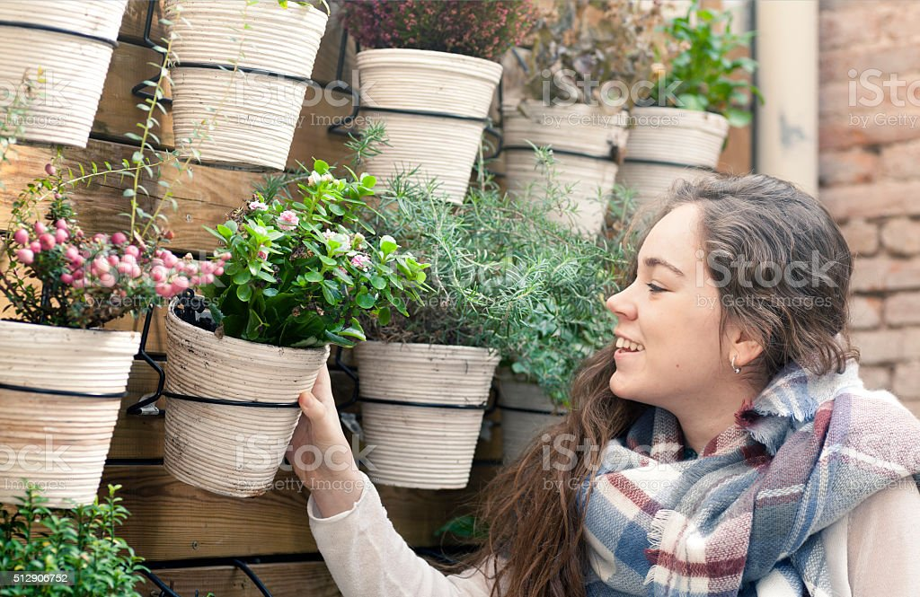 Young woman working in the flower shop stock photo