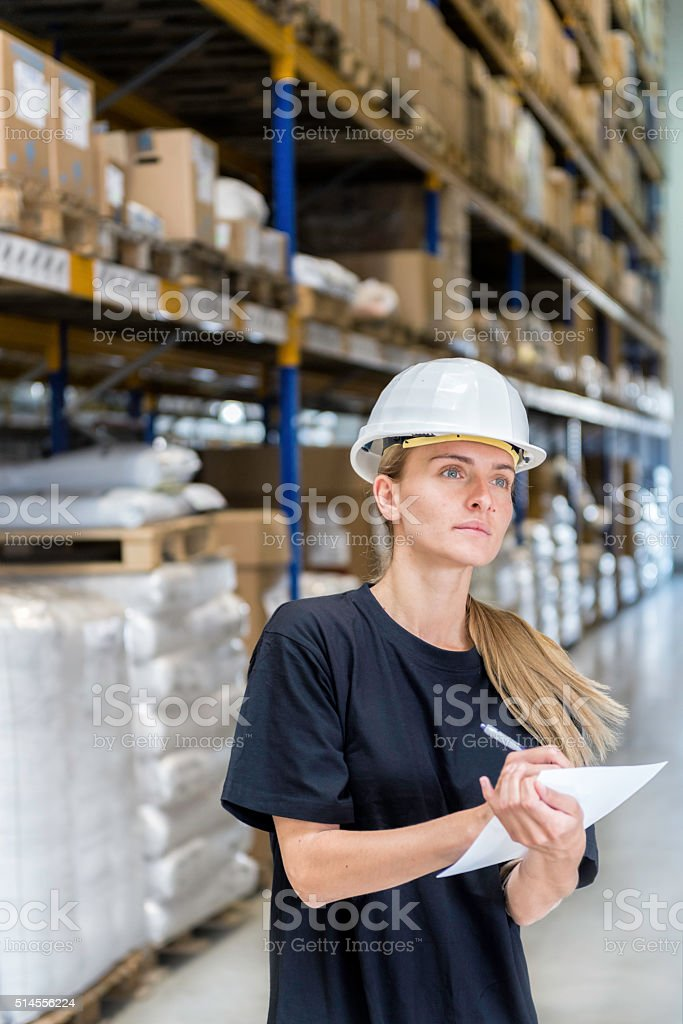 Young woman working in warehouse stock photo