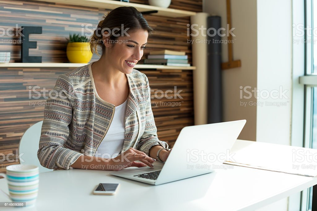 Young Woman Working on a computer stock photo