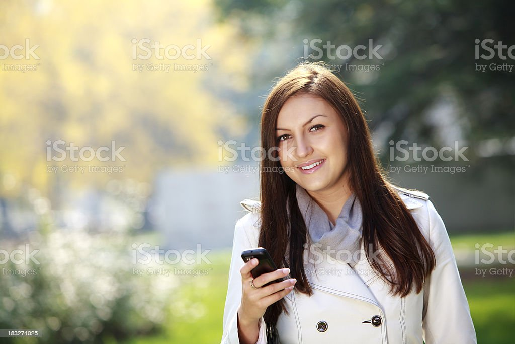 Young woman working on a mobile device royalty-free stock photo