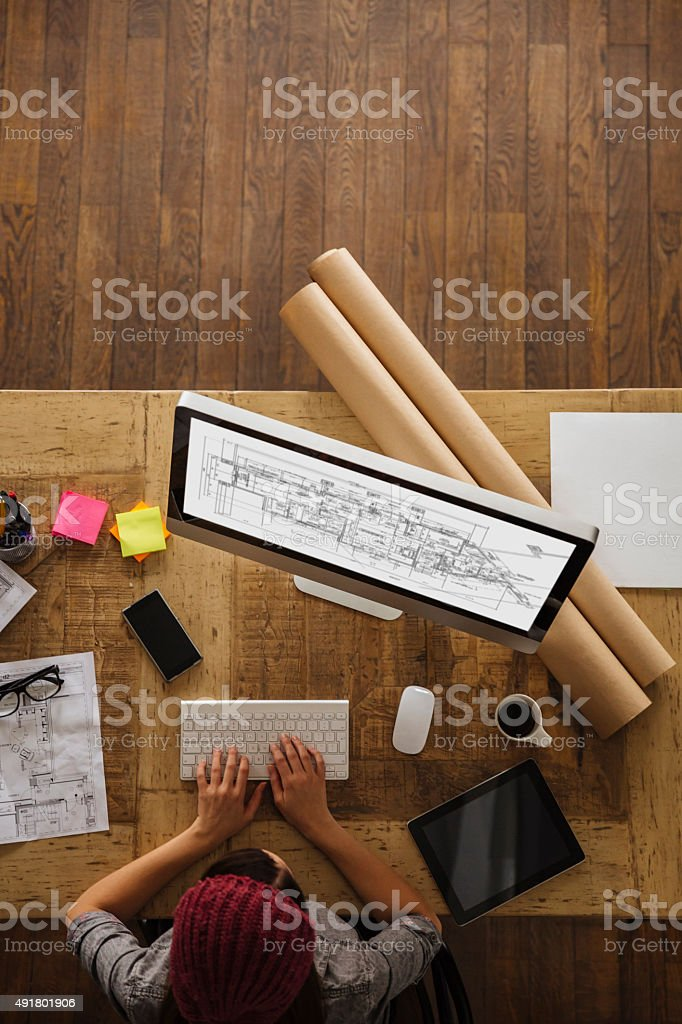 Young woman working on a project stock photo