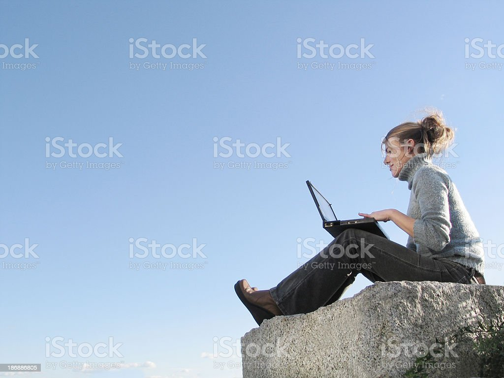 Young woman working on a rock royalty-free stock photo