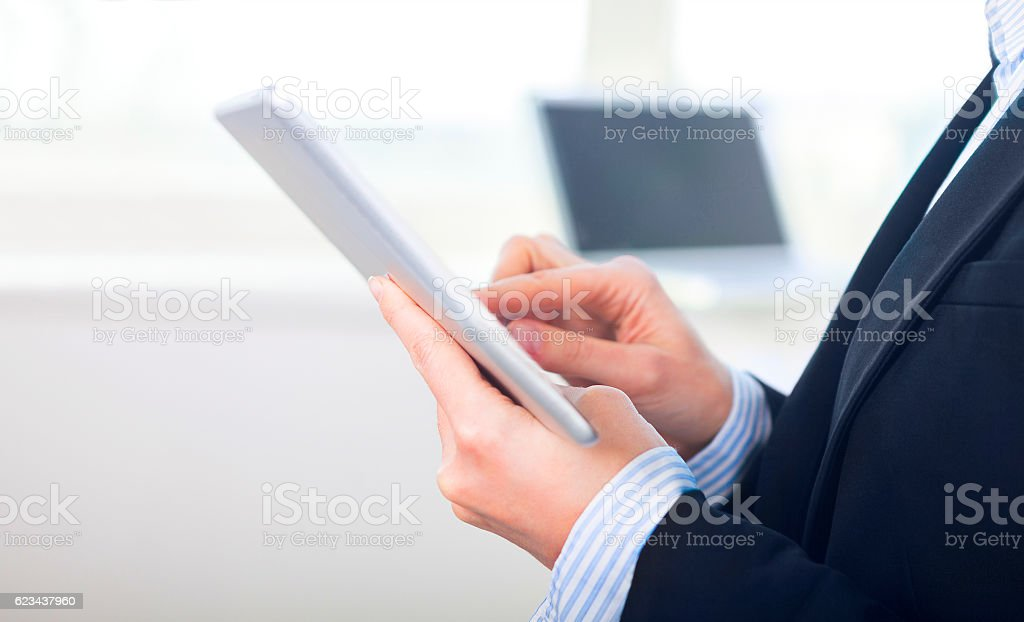 Young woman working on a tablet computer stock photo