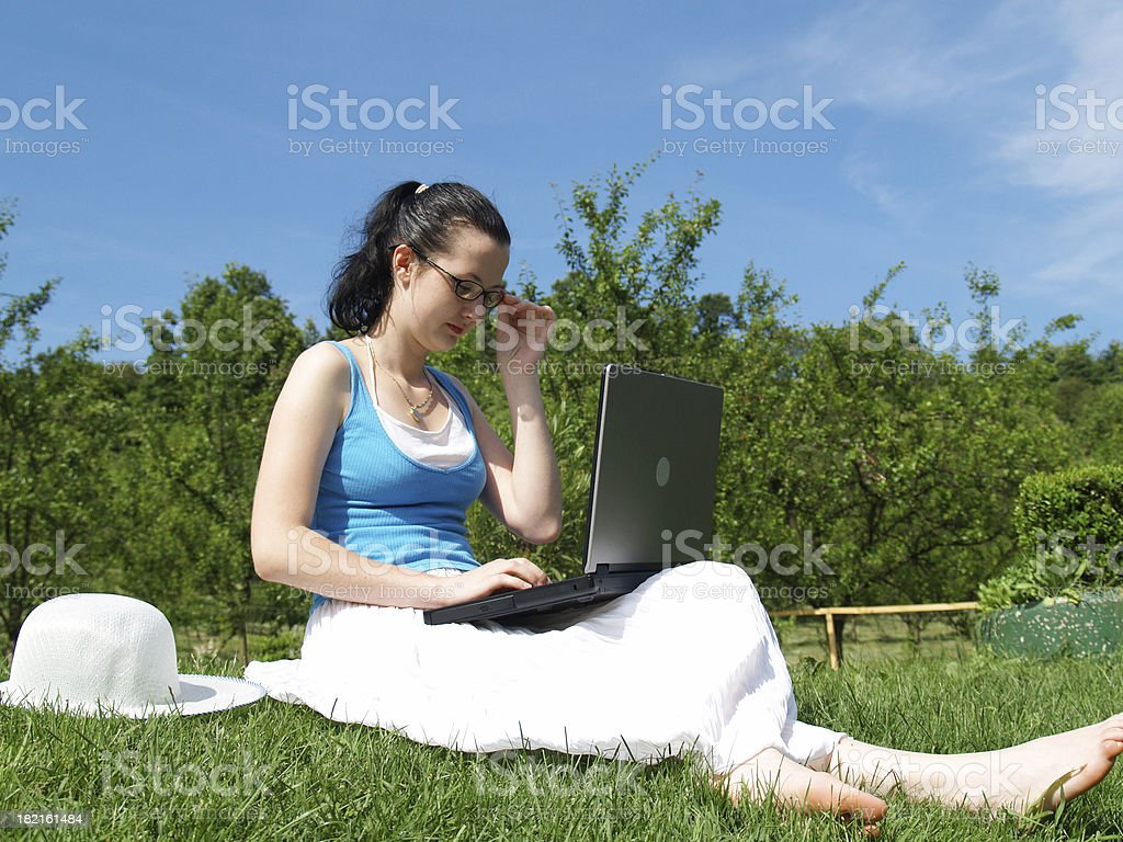 Young woman working on laptop outdoor royalty-free stock photo