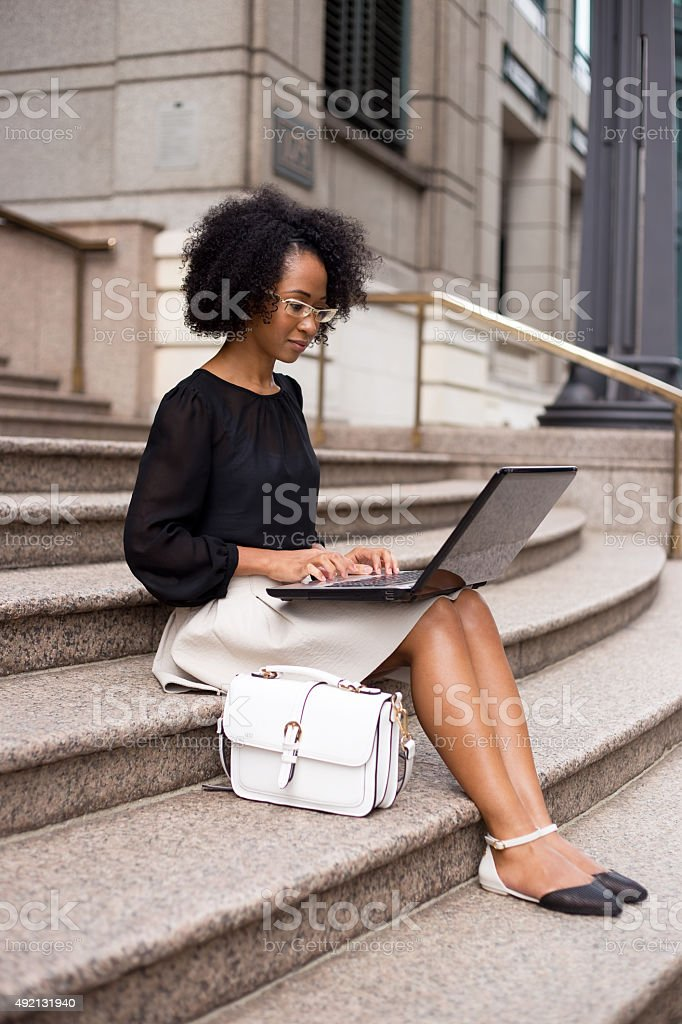 young woman working on laptop royalty-free stock photo