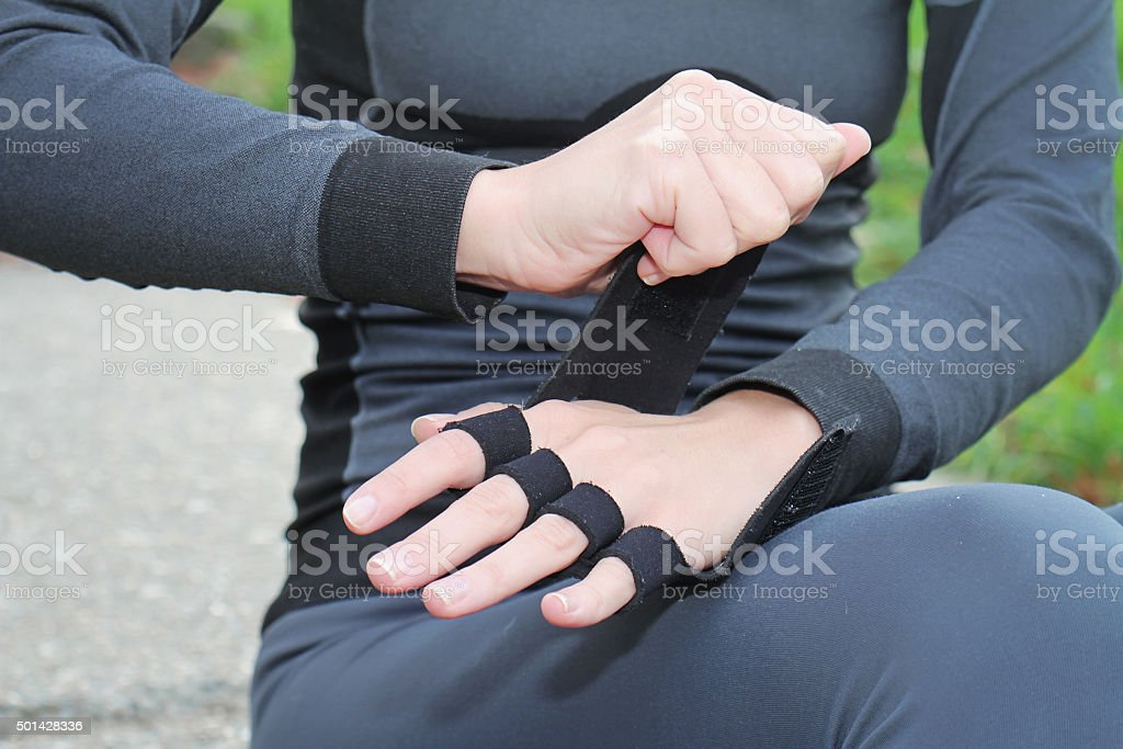 Young woman working out outdoors on cold fall winter day. stock photo