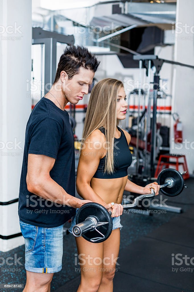 Young Woman Working out with a Personal Trainer stock photo
