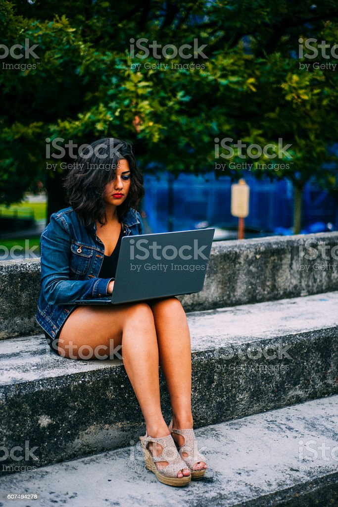 Young woman working outdoors stock photo