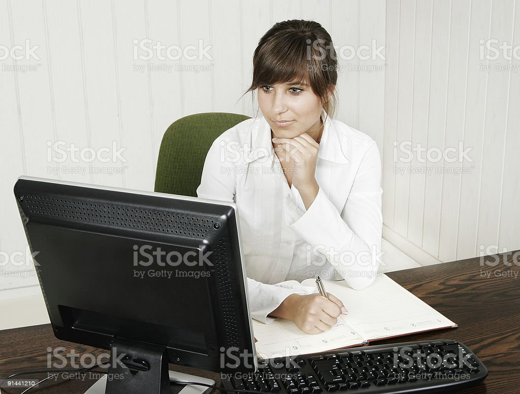 Young woman working with a computer royalty-free stock photo