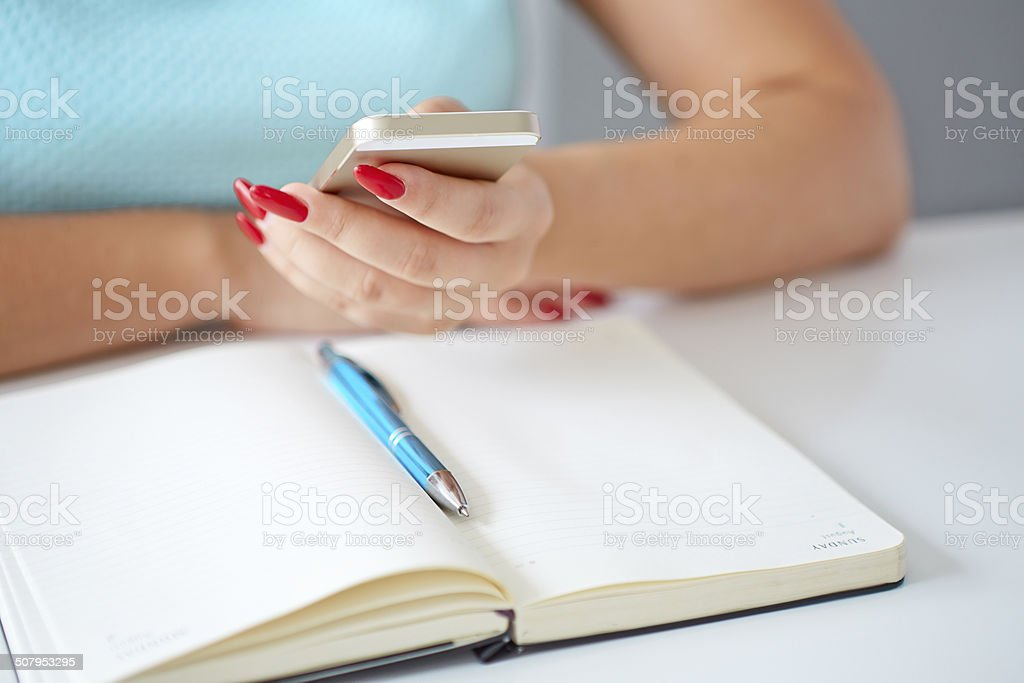 Young woman working with a mobile phone stock photo