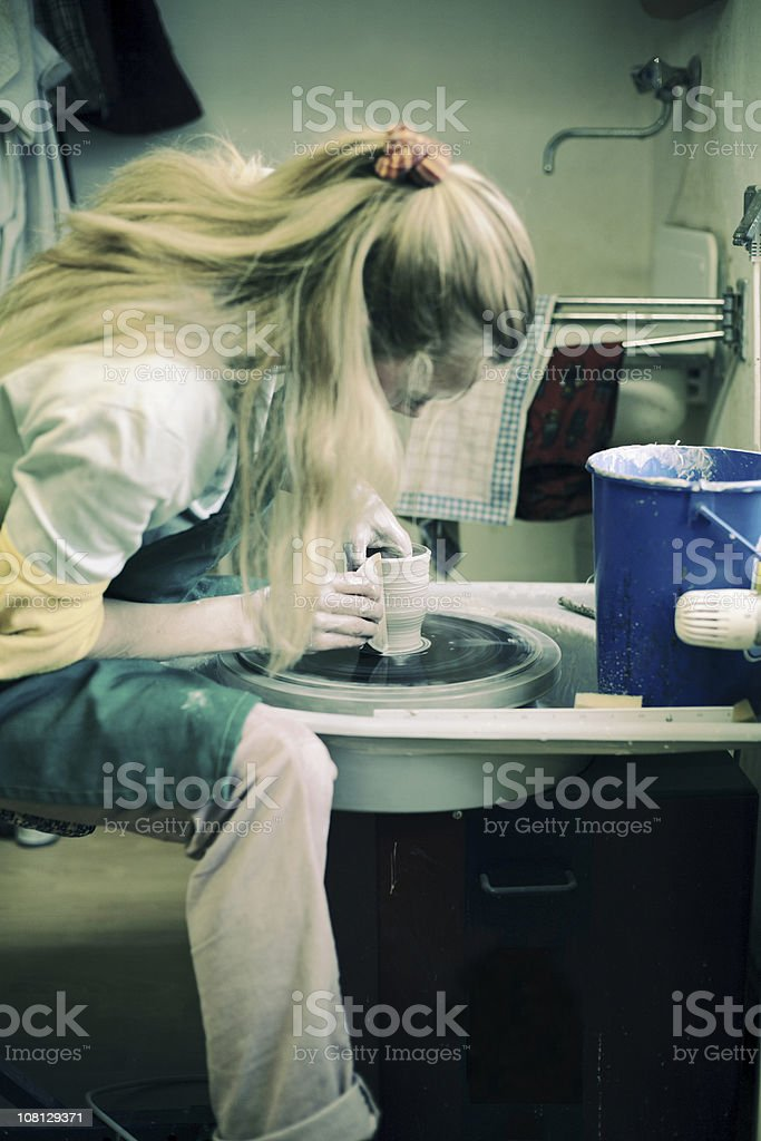 Young Woman Working with Clay stock photo