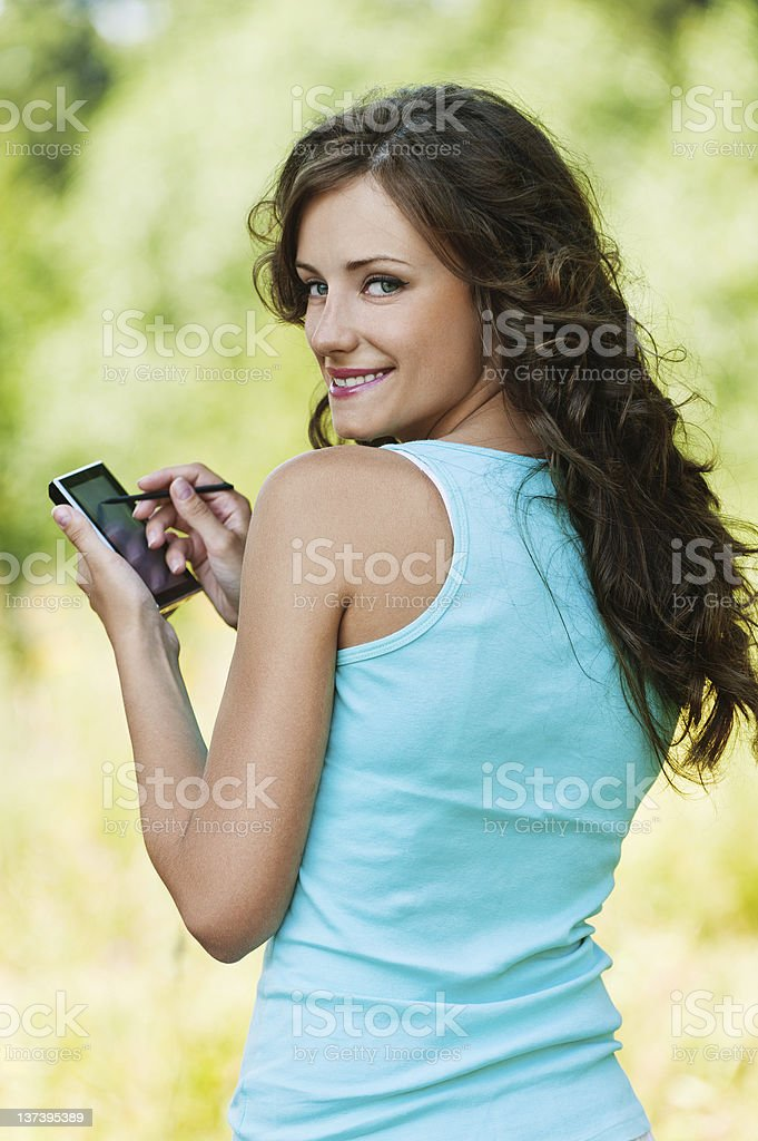 young woman working with smartphone royalty-free stock photo