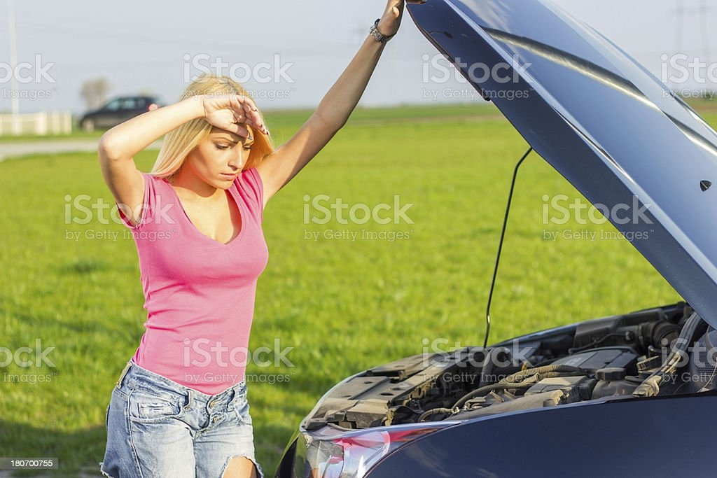 Young woman worried because her car broke down. royalty-free stock photo