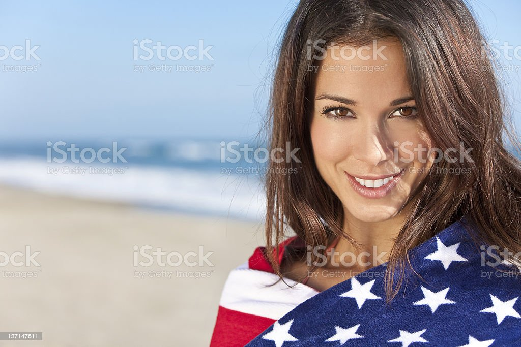 Young Woman Wrapped in American Flag Towel on a Beach royalty-free stock photo