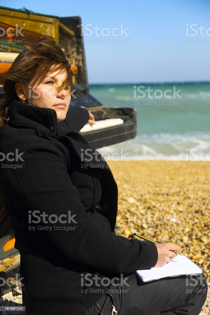 young woman writes on the beach royalty-free stock photo
