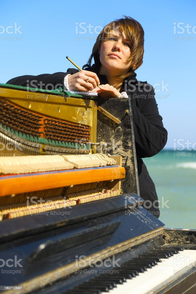 young woman writes on the coast royalty-free stock photo