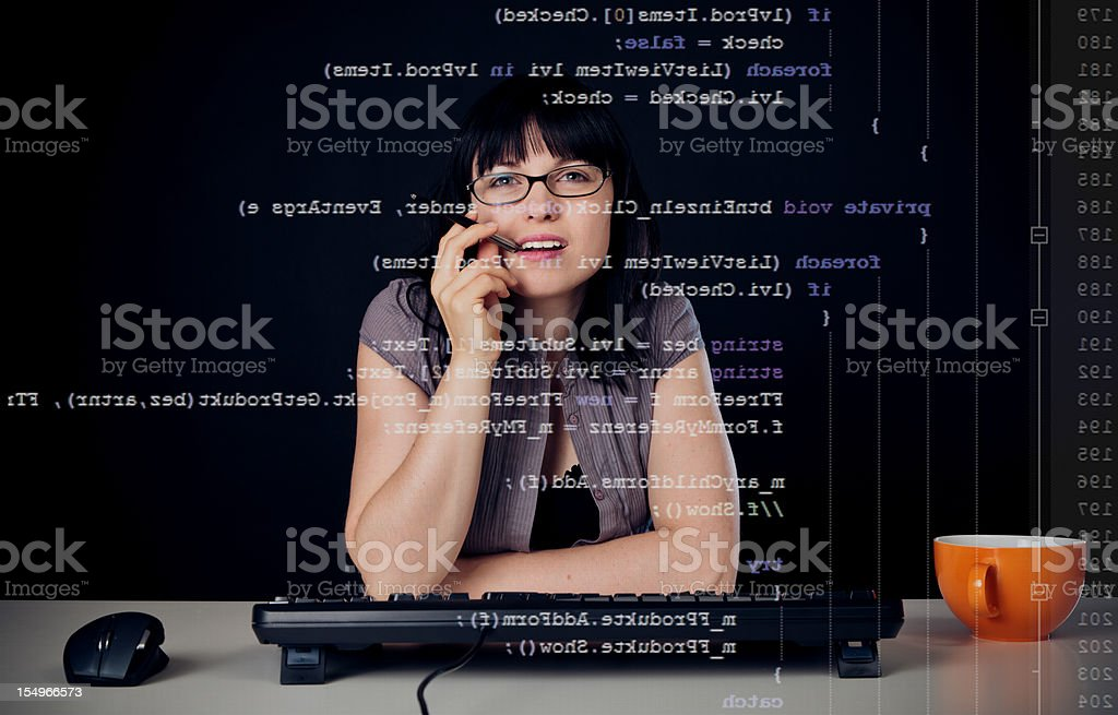 young woman writing a c# program royalty-free stock photo