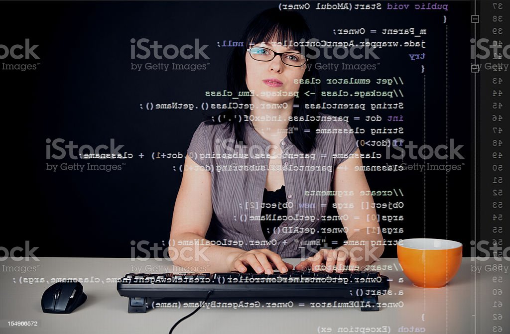 young woman writing a java program royalty-free stock photo