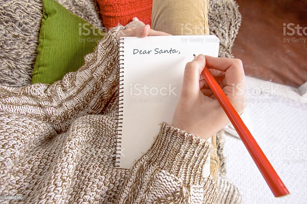 Young woman writing a letter to Santa stock photo