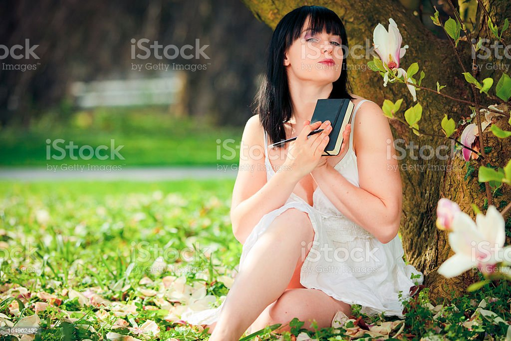 young woman writing her diary royalty-free stock photo