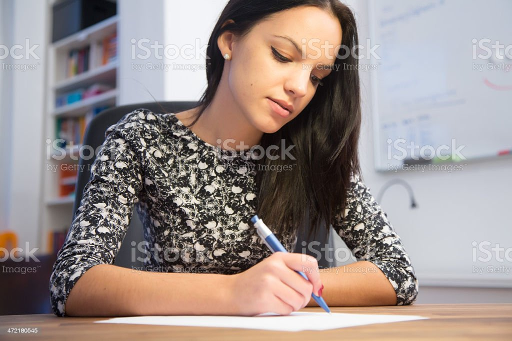 Young woman writing stock photo