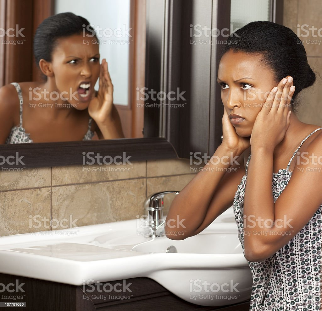 Young woman yelling at herself. stock photo