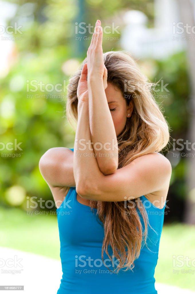 Young Woman Yogi Practicing Yoga in Tropical Environ royalty-free stock photo