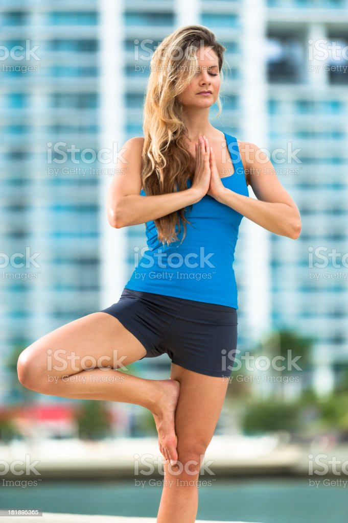 Young Woman Yogi Practicing Yoga in Urban City royalty-free stock photo