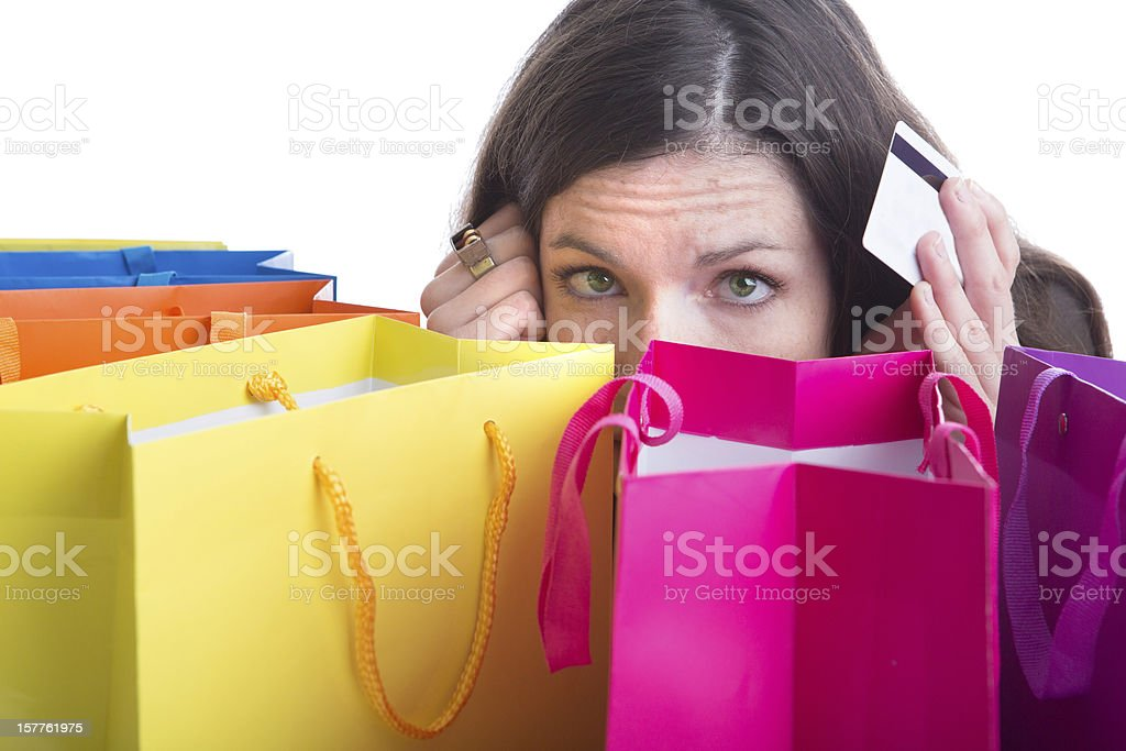 young womanhidden behind shopping bags stock photo