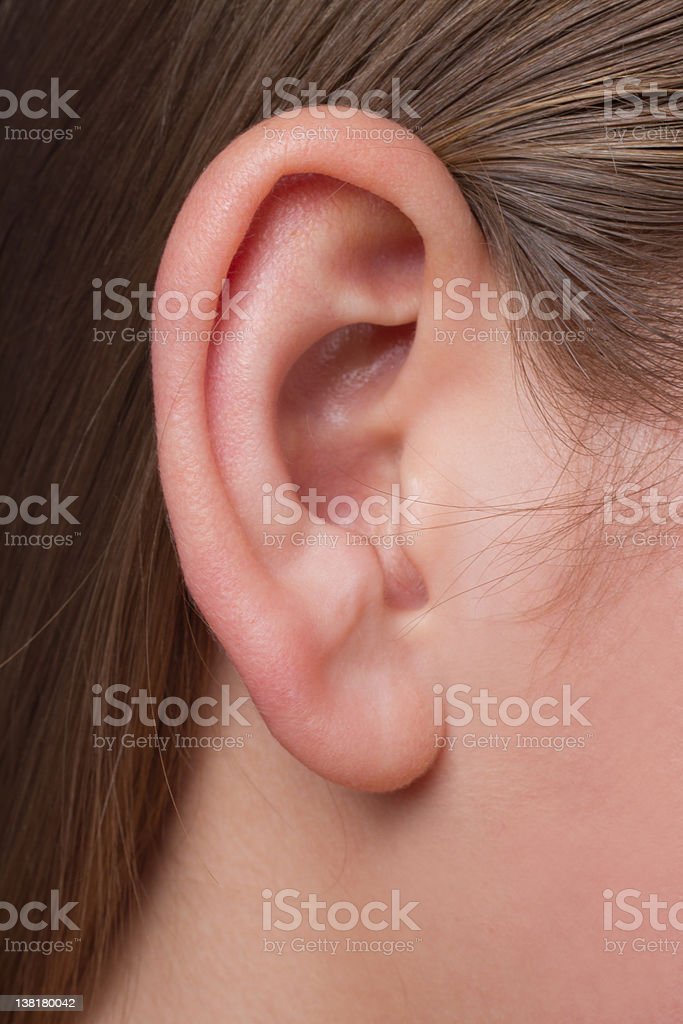 Young woman's ear close-up stock photo