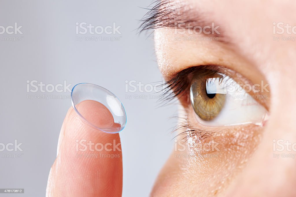 Young womans eye and contact lens stock photo