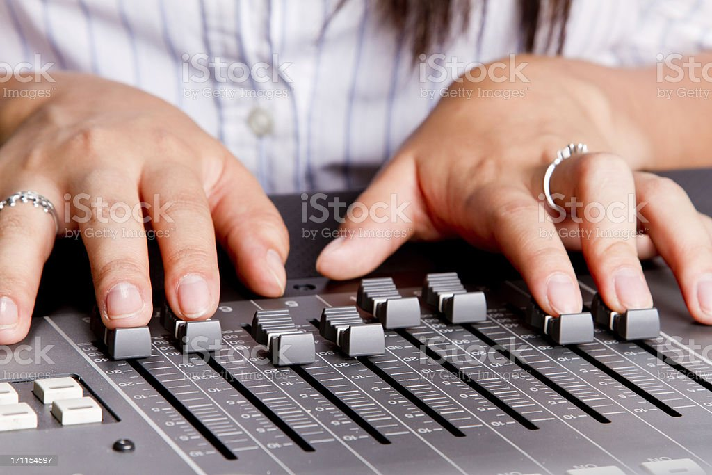 Young Woman's hands at a Recording Console royalty-free stock photo
