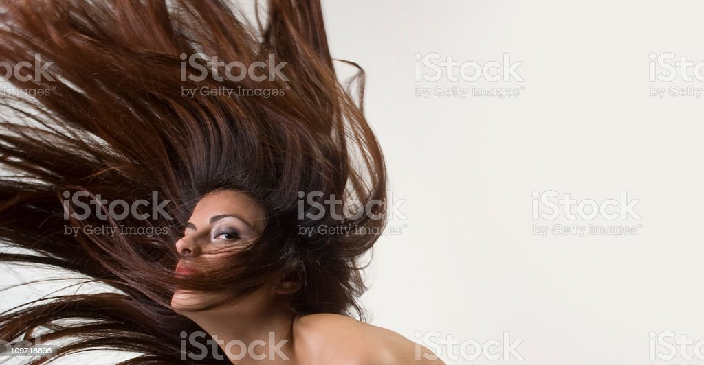 Young Woman's Long Brown Hair in Motion royalty-free stock photo
