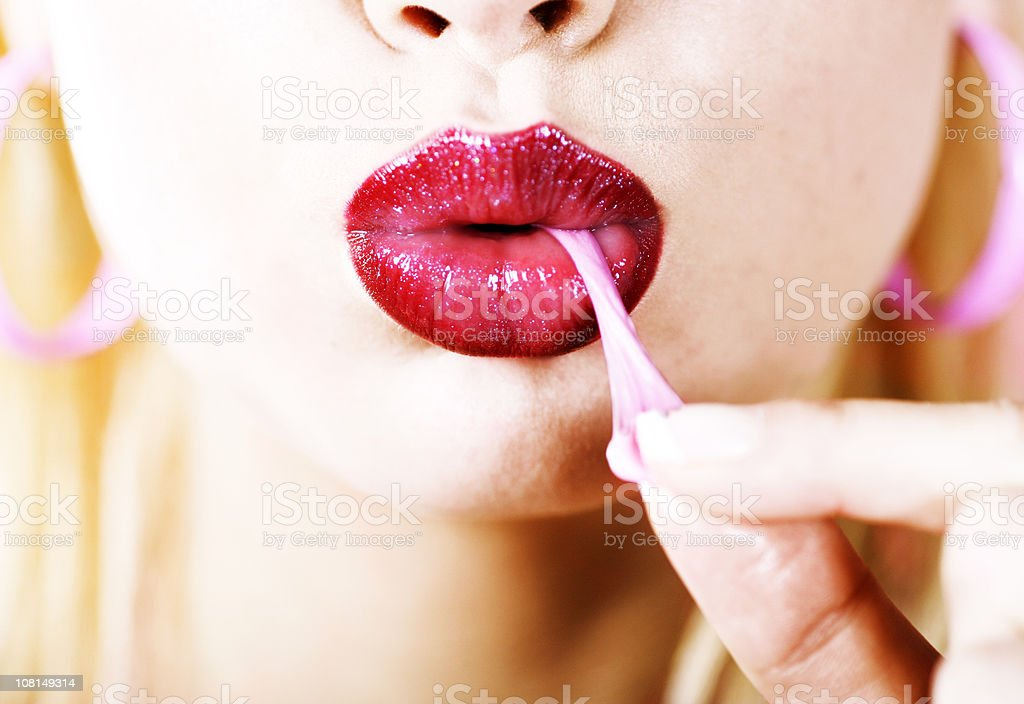 Young Woman's Mouth Pulling Gum stock photo