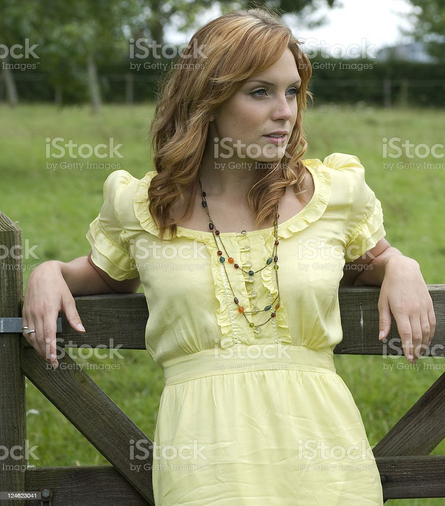 Young Women against a gate stock photo