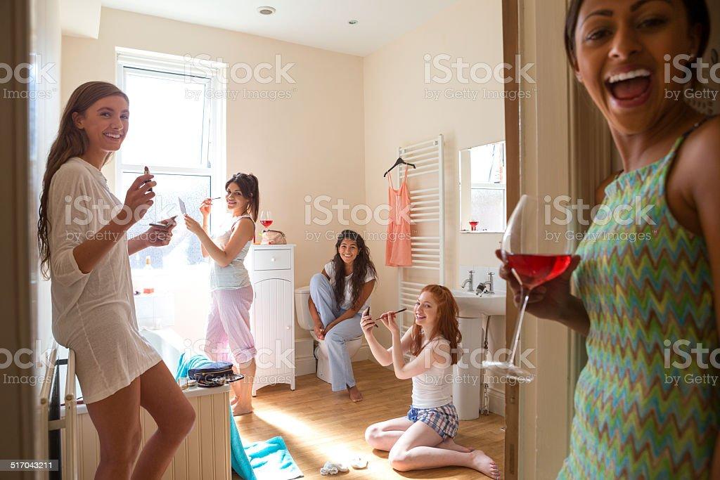 Young Women Applying Make-Up stock photo