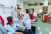 Young women are going to donate blood in  blood bank
