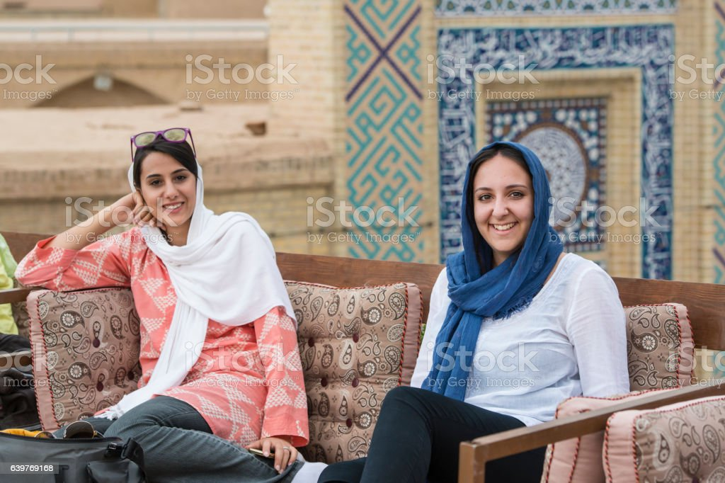 Young women are sitting in a rooftop cafe, Yazd. Iran stock photo