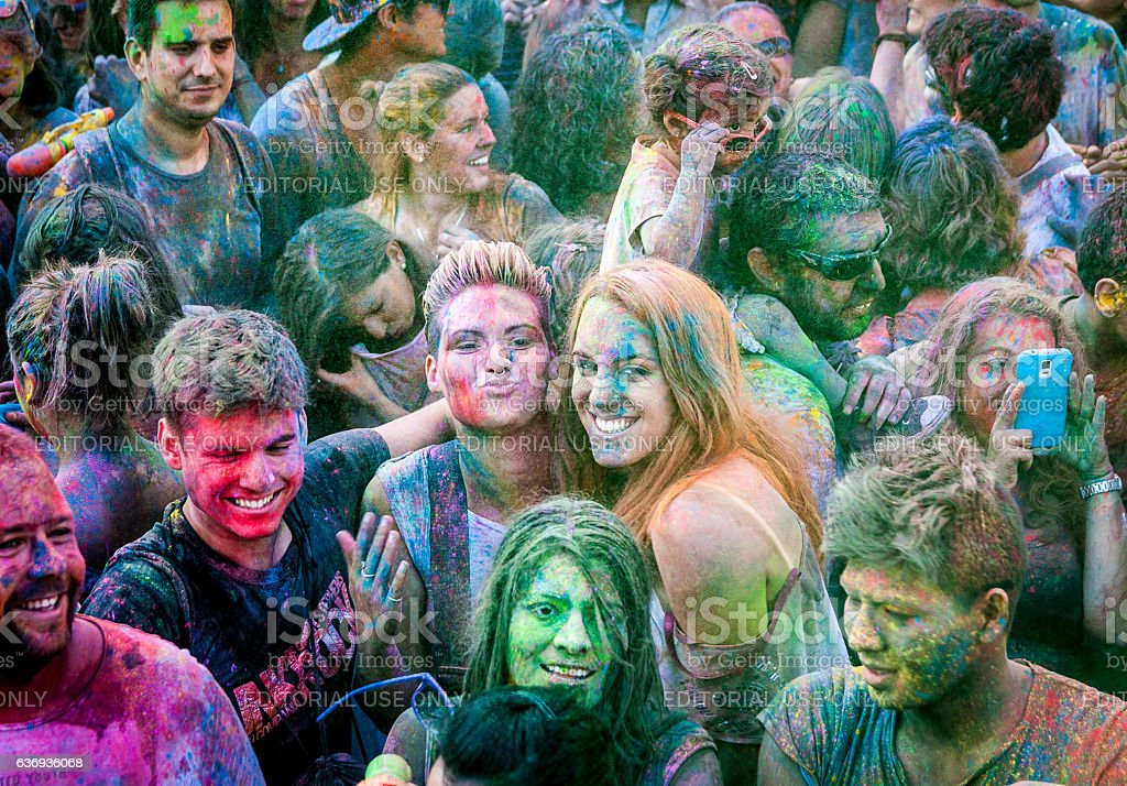 Young women at a colors holi fiesta stock photo