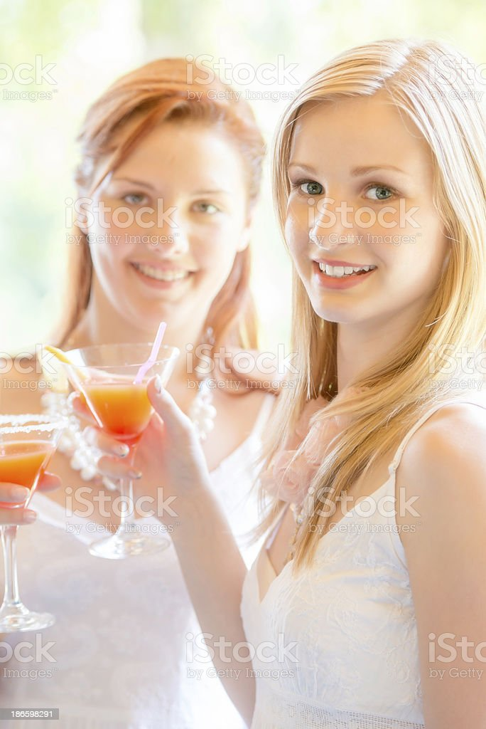 Young Women at Cocktail Party Toasting with Soft Drinks royalty-free stock photo
