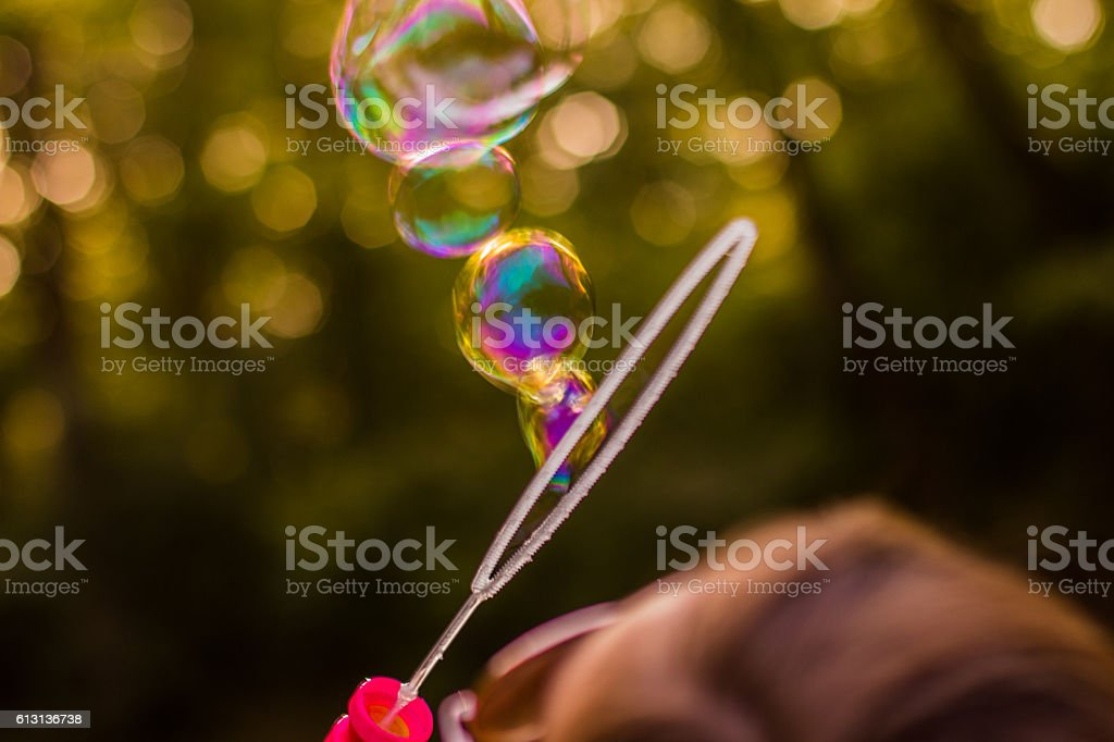 Young women blowing bubbles royalty-free stock photo