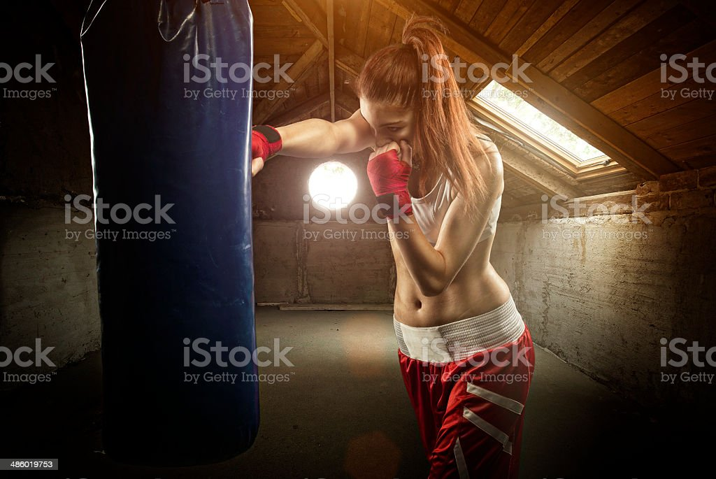 Young women boxing,on the attic stock photo