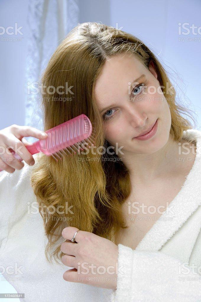 young women brushing hair royalty-free stock photo
