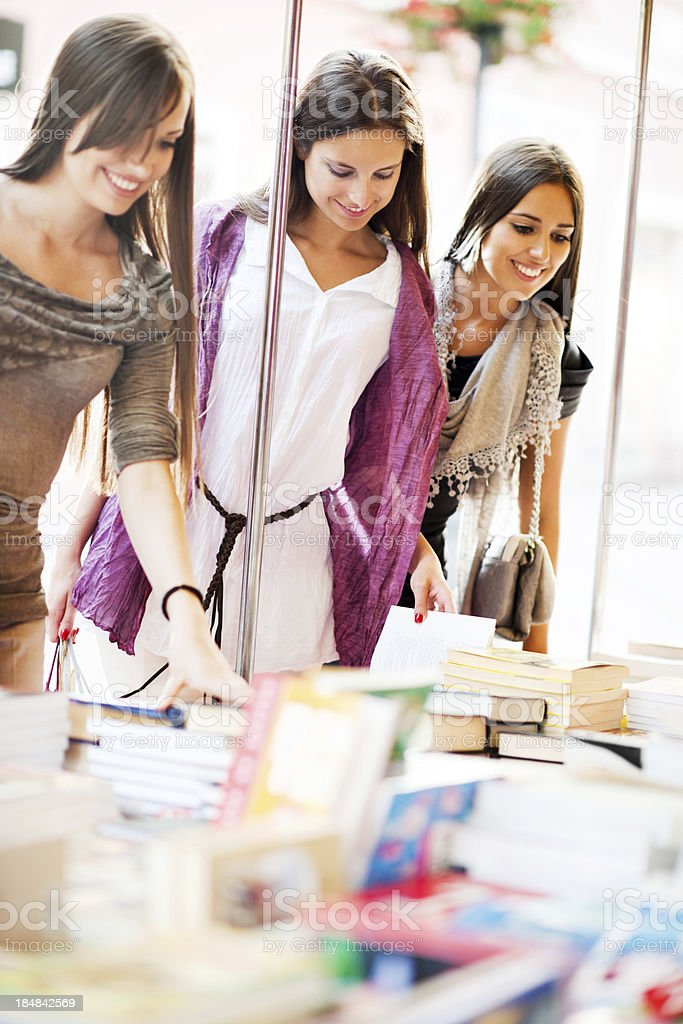 Young women buying books. royalty-free stock photo