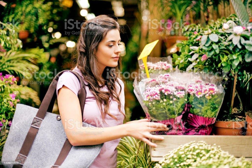 Young women buying flowers at market royalty-free stock photo
