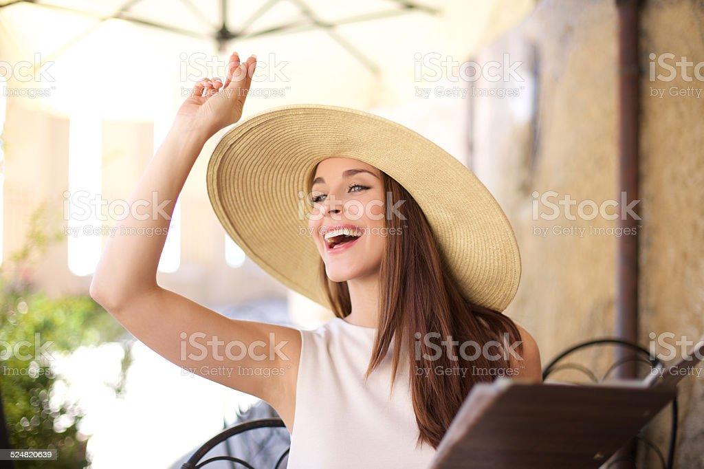 Young women calling the waitress stock photo