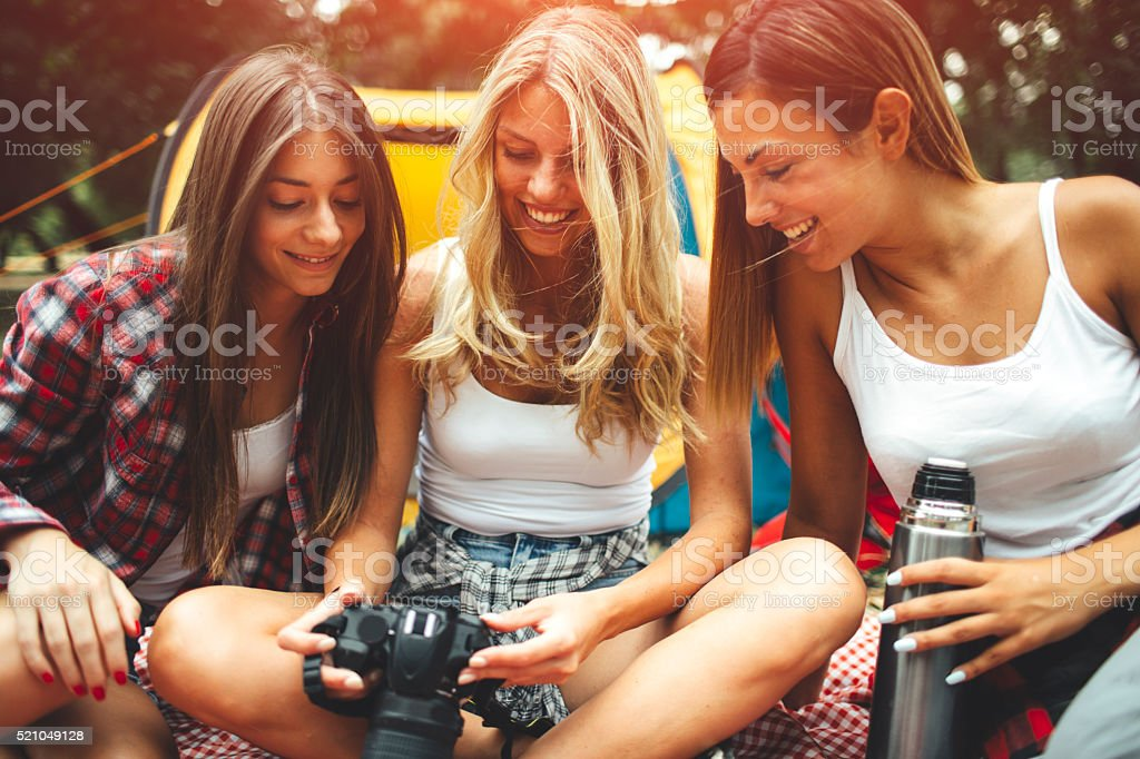 Young Women Camping Together. stock photo