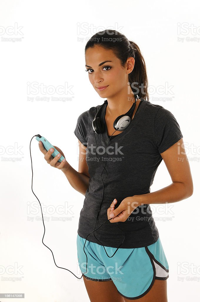 Young Women choosing music on MP3 player royalty-free stock photo