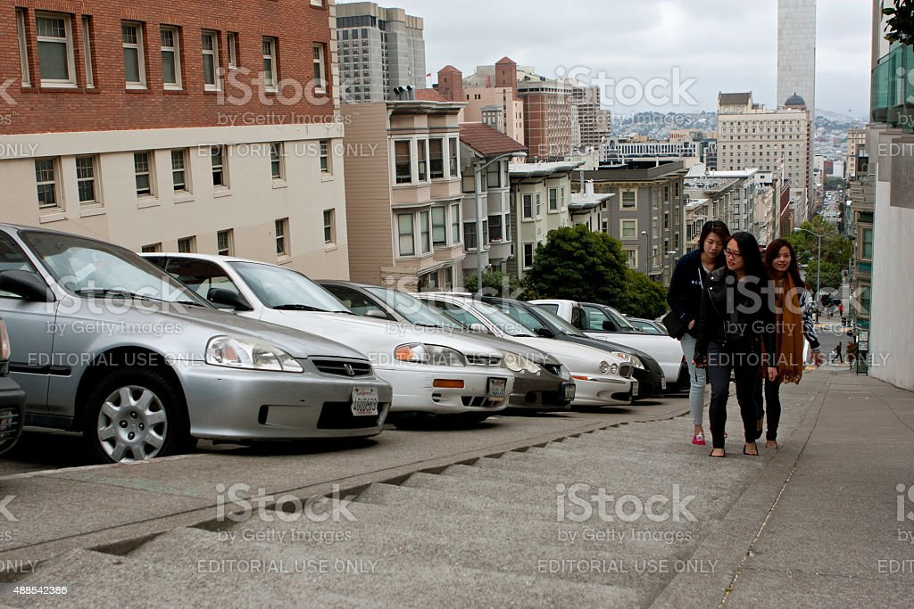 Young Women Climb Steep Concrete Steps In Nob Hill Area stock photo